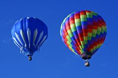 Two Hot Air Balloons. Float in a clear blue sky Stock Photography