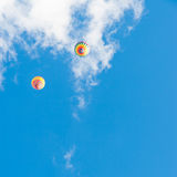Two hot air balloons in blue sky Stock Photography