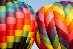Two Hot air balloons bumping Royalty Free Stock Photos