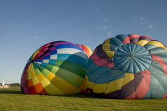 Two hot air balloons inflating on the ground Royalty Free Stock Photography