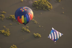 Two hot air balloons over water Stock Photos