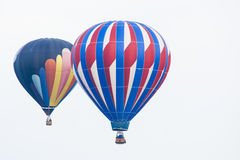 Two hot air balloons in the sky Royalty Free Stock Images
