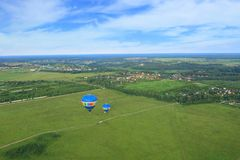 Hot air balloons. Two hot air balloons take off from the field. top view Stock Photography