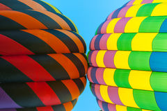 Two hot air balloons touch one another Stock Image