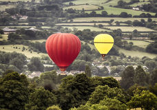 Two hot air baloons drifting Royalty Free Stock Photography