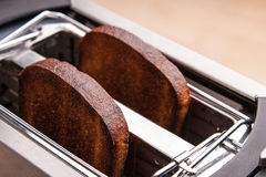 Two hot bread toast in toaster Stock Image