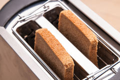 Two hot bread toast in toaster Royalty Free Stock Photography