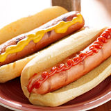Two hot dogs with condiments Stock Photo