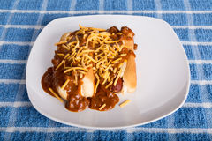 Two Hot Dogs Smothered in Chili and Cheese Royalty Free Stock Photos