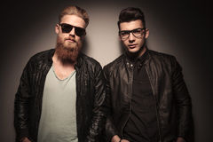 Two hot guys in leather jacket posing Stock Images