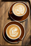 Two hot latte Stock Images