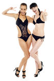 Two hot sexy babes in black bikinis Royalty Free Stock Photography
