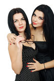 Two hot sexy brunette. With red lips Royalty Free Stock Images