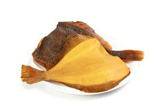 Two hot smoked flatfish on plate Stock Photos