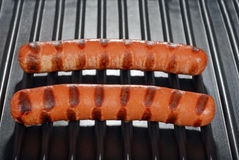 Two hotdogs on a grill Royalty Free Stock Image