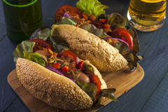 Two hotdogs with sausages and vegetables Royalty Free Stock Photos