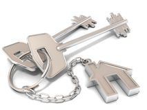Two house door keys and house key-chain. On white background Stock Photos