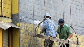 Two house painter at work. UKRAINE, KIEV, SEPTEMBER 7, 2010: Two house painter at work in Kiev, Ukraine, September, 7, 2010 stock footage