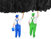 Two house painters cover invisible wall Royalty Free Stock Photography