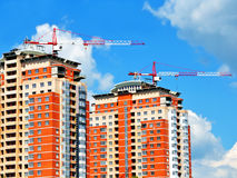 Two houses. Building of new high-rise housing against the blue sky Stock Image
