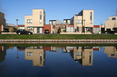 Two houses. And their reflections in a modern suburb Royalty Free Stock Photography