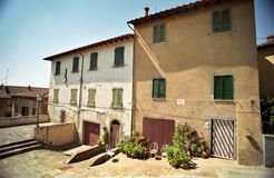 Two houses in Italy. With closed windows at noon Royalty Free Stock Photos