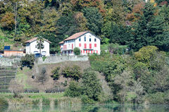 Two houses on the lakeside of Muzzano Royalty Free Stock Image
