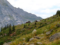 Two houses made of wood on a Alpine mountain, gauli glacier in Switzerland alps Stock Photos