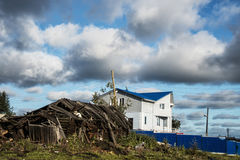 Two houses, old and new. On the background of blue sky with white clouds. Arkhangelsk. The North Of Russia Stock Images