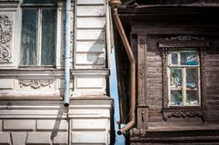 Two houses in Russia: old wooden and brick. Stock Images