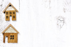 Two houses on wooden background - real estate property concept Royalty Free Stock Photos