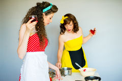 Two housewifes in the kitchen Royalty Free Stock Photos