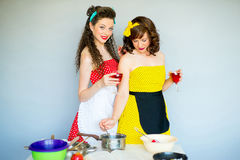 Two housewifes in the kitchen Stock Photo
