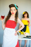 Two housewifes in the kitchen Royalty Free Stock Photo