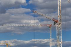 Two huge construction cranes on a construction site stock images