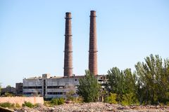 Two huge old brick chimneys of combined heat and power plant Stock Images