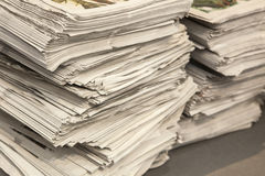 Two huge pile of many newspapers Stock Photo