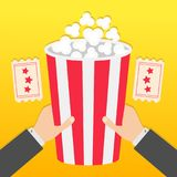 Two human businessman hands holding big popcorn box. Two Tickets with stars. Movie Cinema icon in flat design style. Pop corn. Fas. T food. Yellow gradient Royalty Free Stock Image
