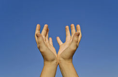 Two Human Hands On A Clear Sky. Background Stock Photos