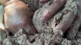 Two human hands knead minced meat stock video footage