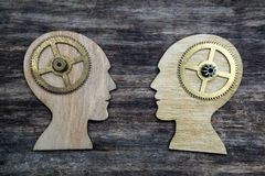 Two human head silhouettes with gears Royalty Free Stock Photo