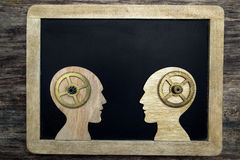 Two human head silhouettes with gears Stock Image