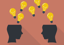 Two human head thinking a new idea. Royalty Free Stock Image