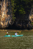 Two human on one canoe Royalty Free Stock Photo