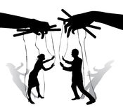 Two human puppets talk and argue. Hands holding the strings with silhouettes of men and women Stock Images