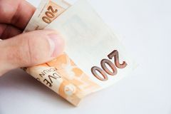 Two hundred crowns. Czech two-hundred banknote money, holding in a hand Stock Photography