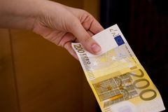 Two hundred euro banknote. Intention to make a payment with a two hundred euro bill Royalty Free Stock Images