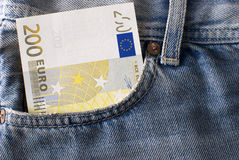 Two hundred Euro banknote in jeans pocket. Close-up of  two hundred Euro banknote in jeans pocket Stock Photos