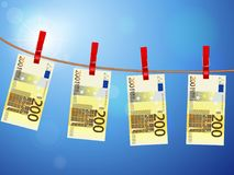 Two hundred euro banknotes on clothesline Stock Photography