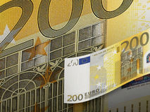 Two hundred euro bill collage in warm tone. Horizontal format Royalty Free Stock Photo